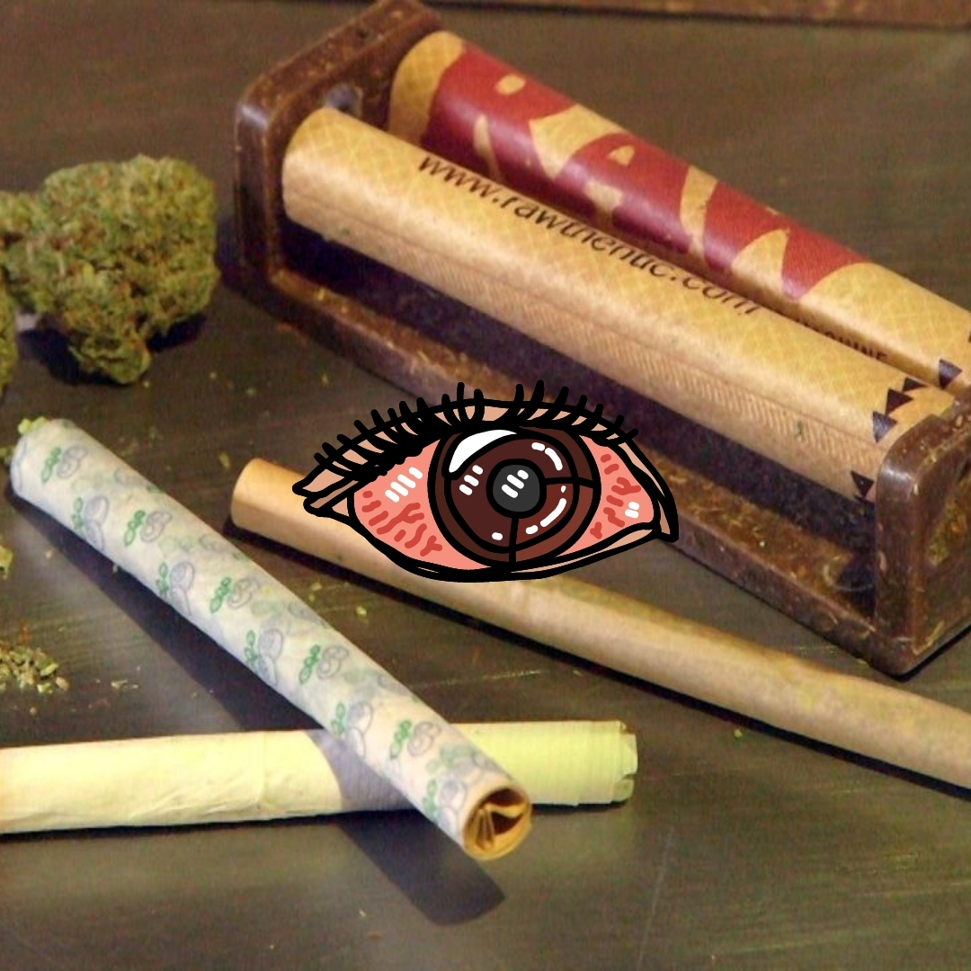 rolling a joint with dry herb around on the table with animation of red eyes