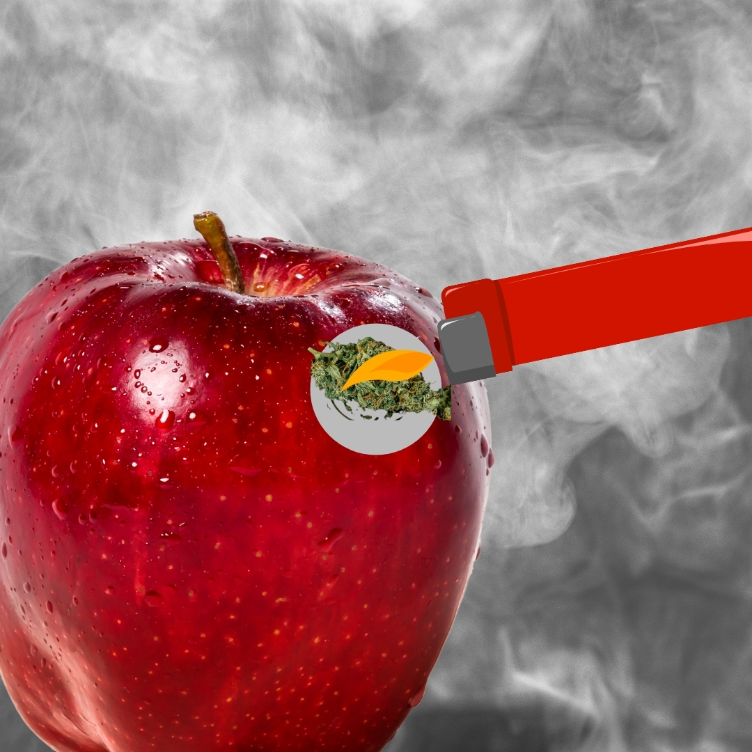 apple being smoked out of with a lighter hemp in the background