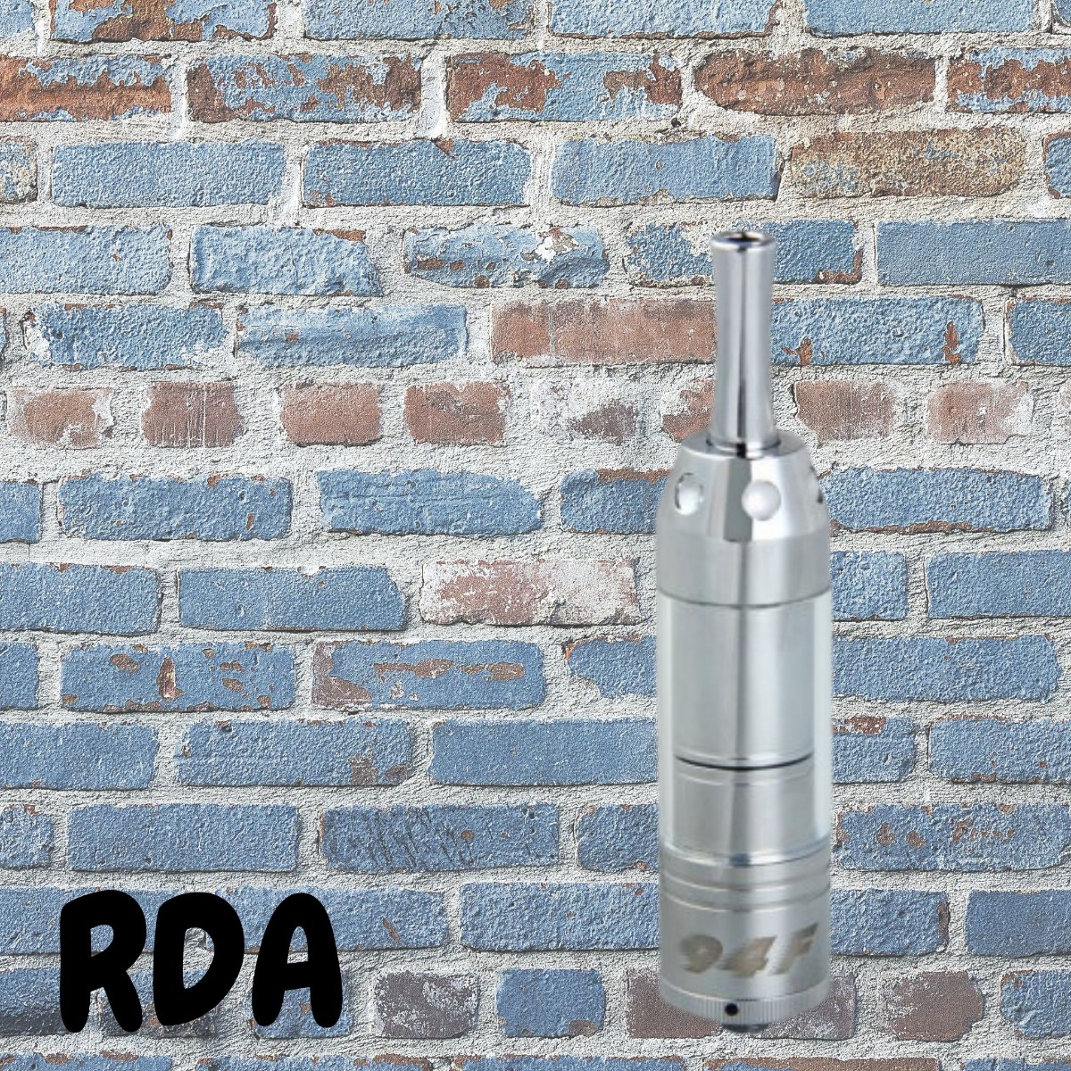 RDA atomizer in front of a brick wall